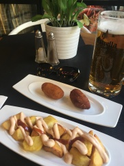 tapas - stuffed potatoes with minced meat & fried potatoes